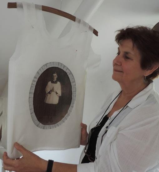 PAPER DRESS EXHIBIT CAPTURES ARTIST'S ANCESTRY